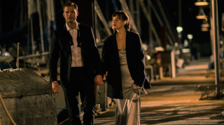 Fifty Shades Darker's costume designer and makeup department head tell The Knot exactly what Anastasia Steele was wearing when Christian Grey proposed—find out here. (Credit: Universal Pictures)