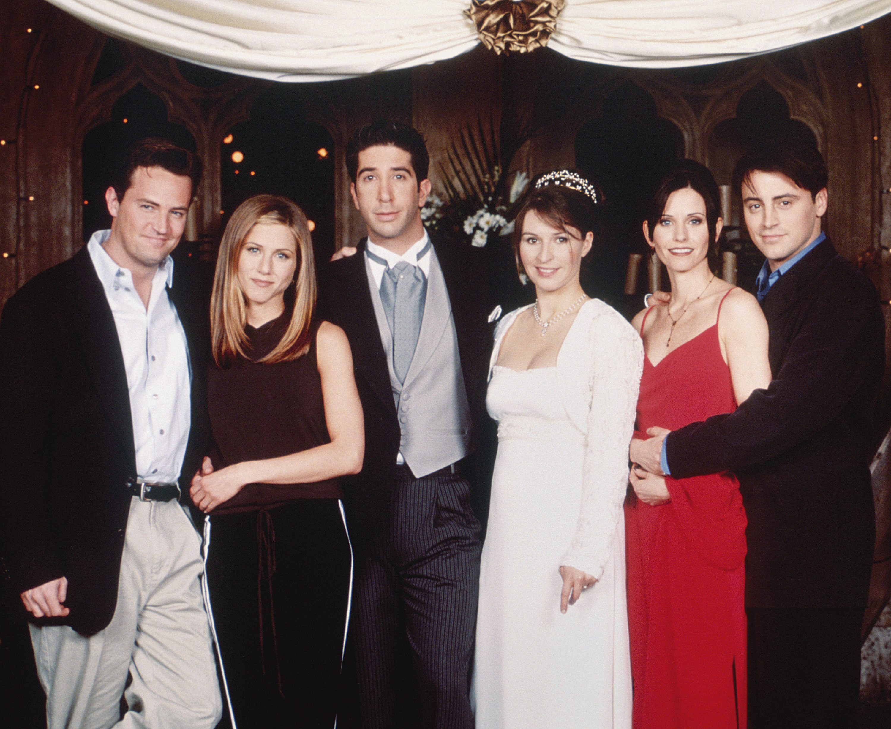 "FRIENDS -- ""The One with Ross's Wedding: Part 2"" Episode 24 -- Pictured: (l-r) Matthew Perry as Chandler Bing, Jennifer Aniston as Rachel Green, David Schwimmer as Ross Geller, Helen Baxendale as Emily Waltham, Courteney Cox as Monica Geller, Matt LeBlanc as Joey Tribbiani (Photo by Oliver Upton/NBC/NBCU Photo Bank via Getty Images)"