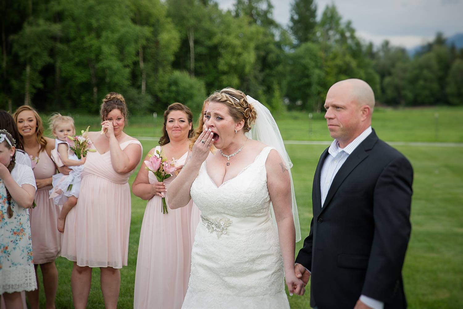 A bride received the surprise of a lifetime on her wedding day when a special guest carrying her late son's heart introduced himself during the ceremony. (Credit: Love Adventured)