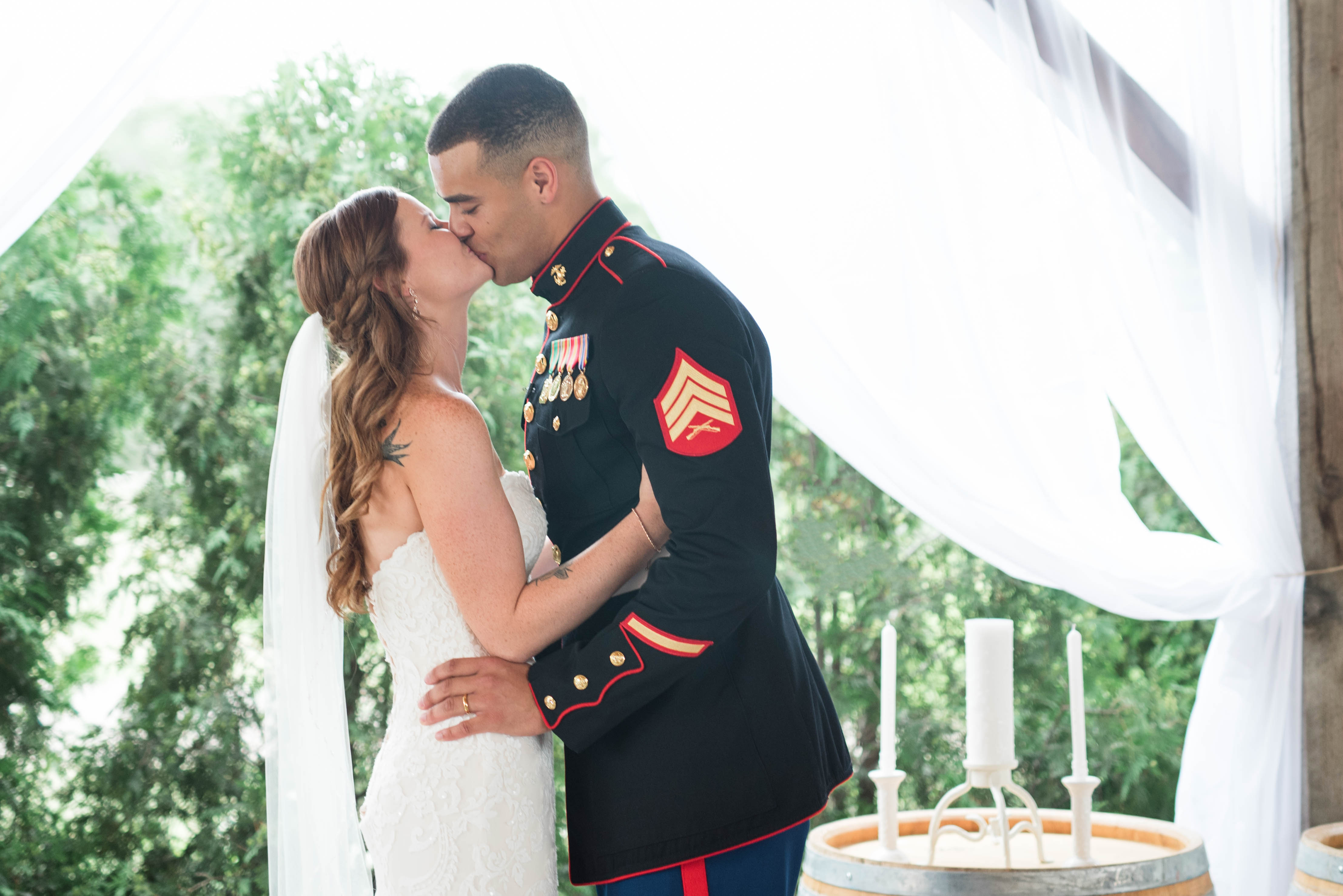 A marine's son wept in his new stepmom's arms at the wedding. (Credit: Jessica Husted Photography)