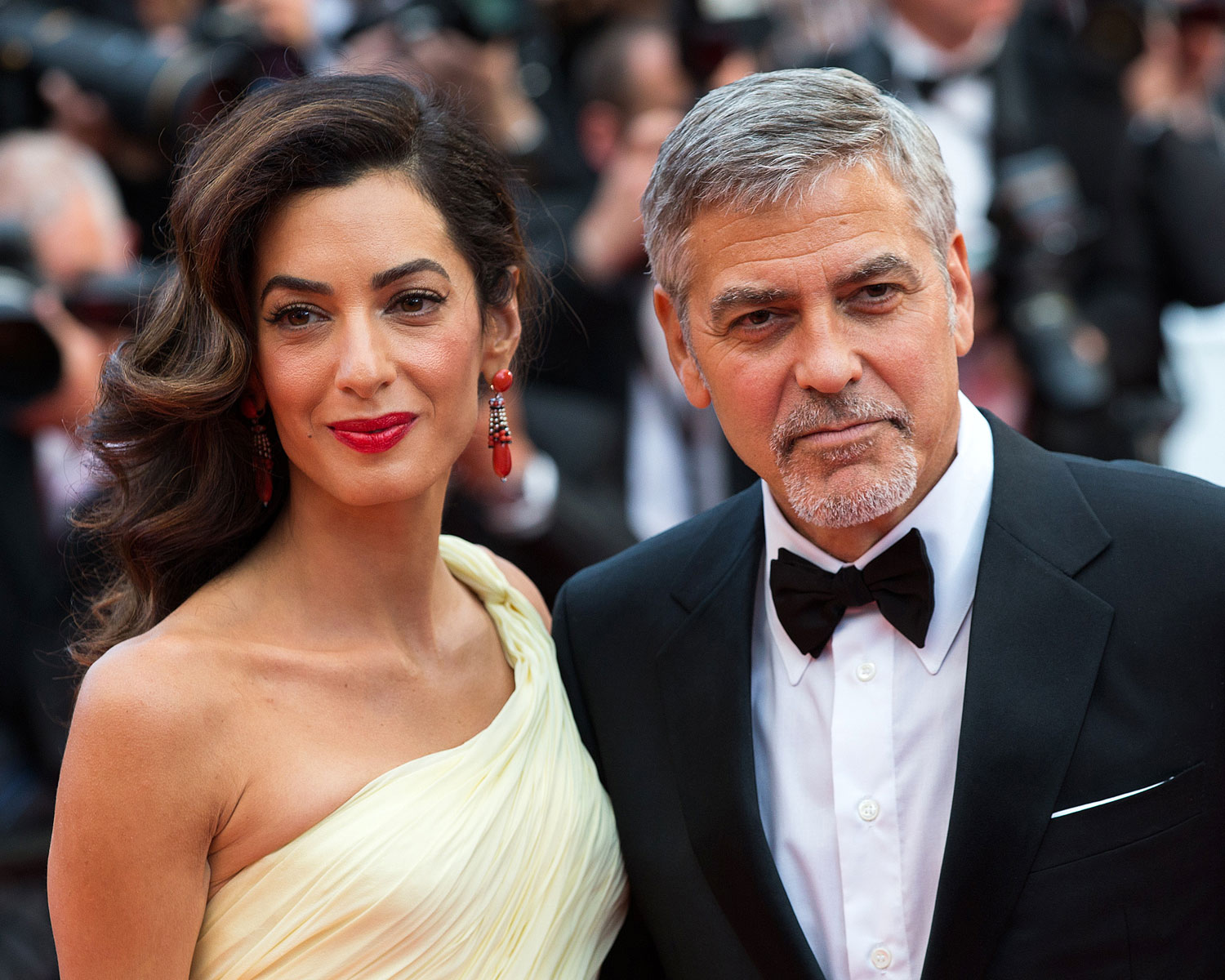 George Clooney's wife Amal struggles with dress as she ...
