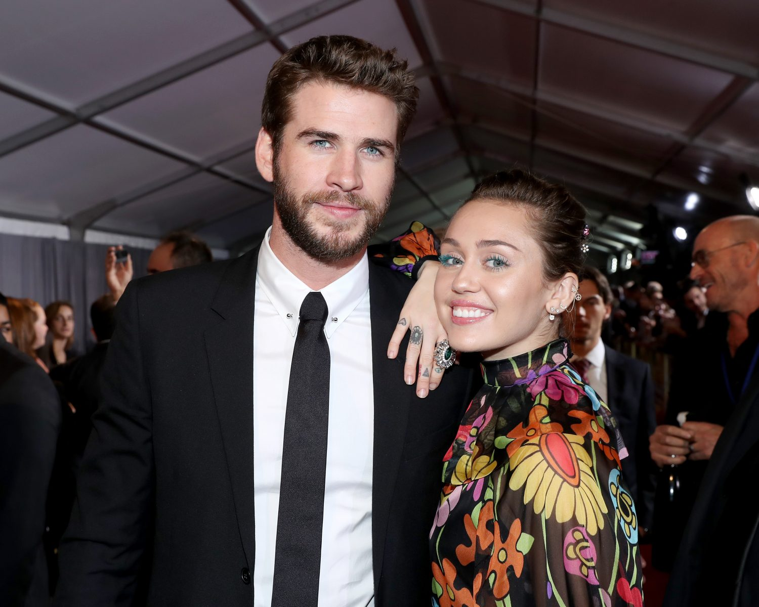 13b6fb164 HOLLYWOOD, CA - OCTOBER 10: Actor Liam Hemsworth (L) and Miley Cyrus at The  World Premiere of Marvel Studios'
