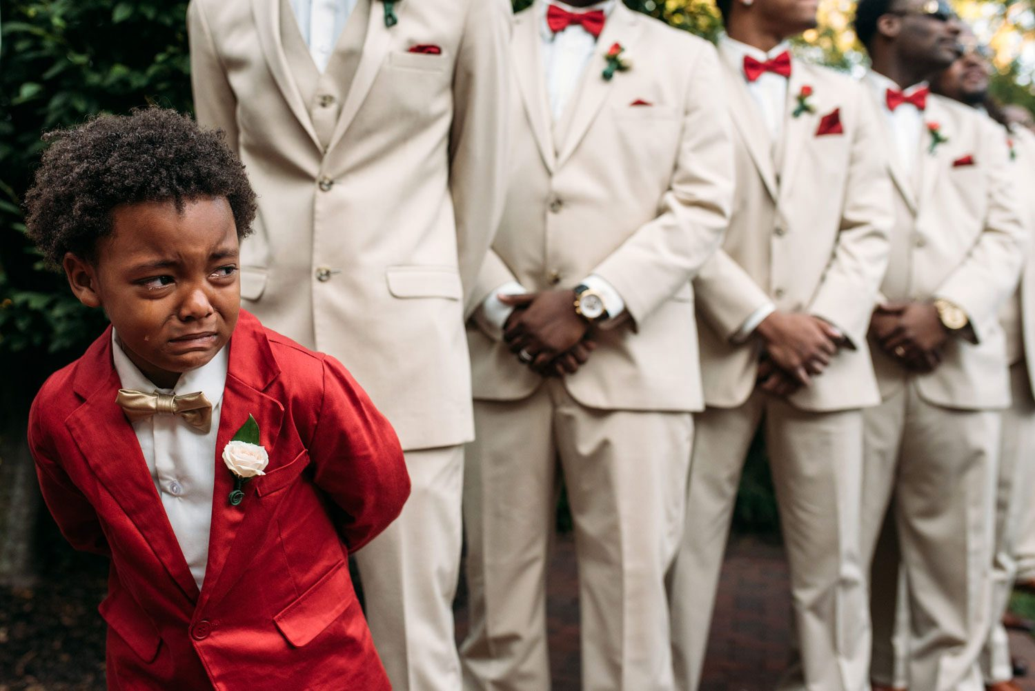 Boy crying mom wedding photographer