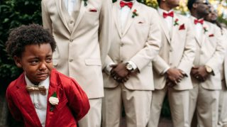 Boy crying mom wedding photographer