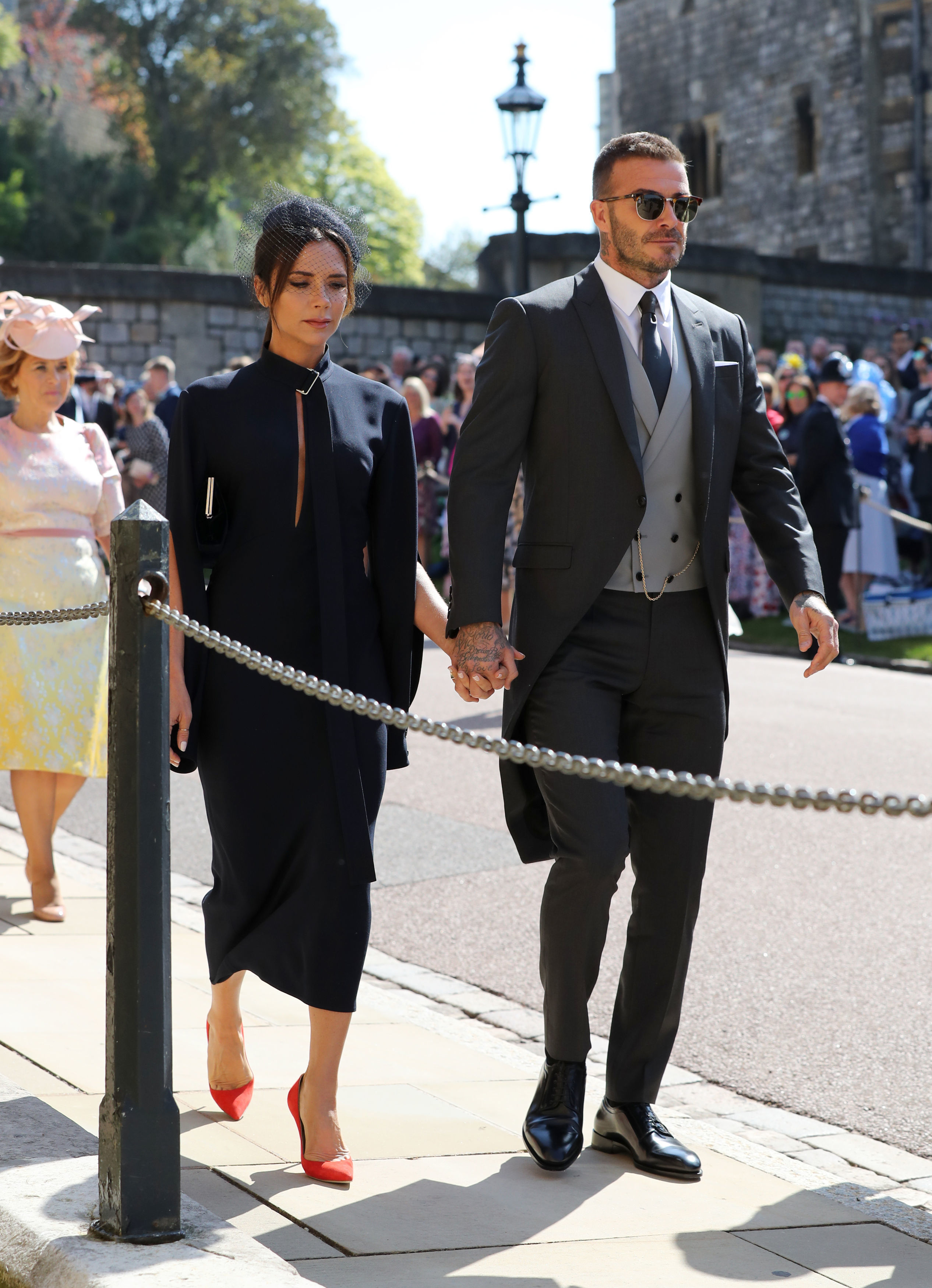 43feaddd794fc Former England footballer David Beckham (R) arrives with his wife Victoria  for the wedding ceremony of Britain s Prince Harry