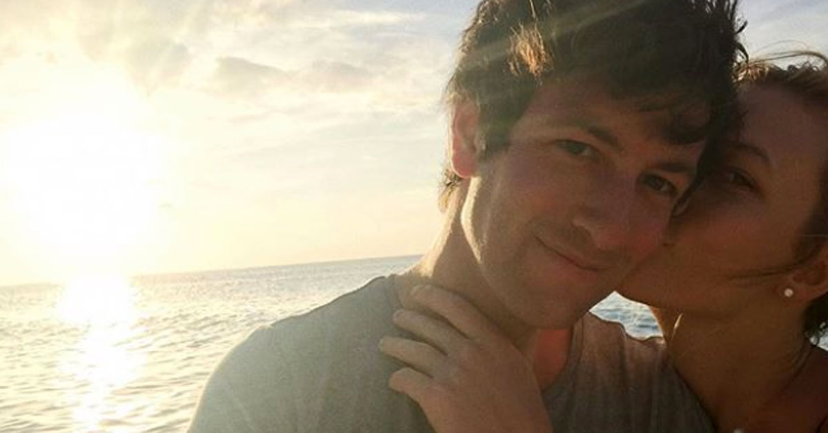 Karlie Kloss smiles with Joshua Kushner in a selfie in front of a sunset.