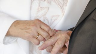 old couple rings wedding