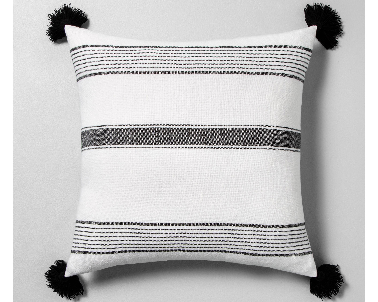 White and gray striped pillow